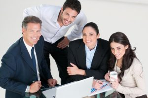 project-team-working-smiling-586x389
